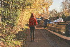 Woman walking by canal Royalty Free Stock Photos