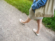 Woman walking carefree on rural path stock photography