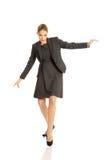 Woman walking carefully Stock Image