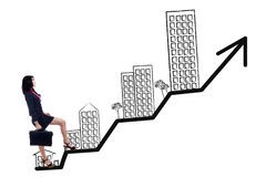 Woman walking on the chart of residential business Stock Images