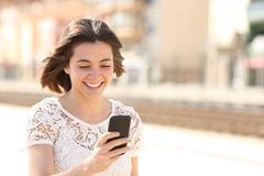 Woman walking checking smart phone content royalty free stock photo