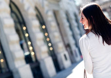 Woman walking in the city Royalty Free Stock Photos