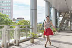 Woman walking in the city Stock Photo