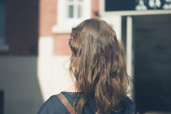 Woman walking in the city Stock Photography