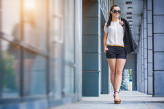 Woman walking in the city Royalty Free Stock Photography