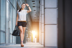 Woman walking in the city Royalty Free Stock Photo