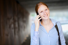 Woman Walking in City and Calling by Phone Royalty Free Stock Images