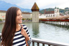 Woman walking in city of Lucerne in Switzerland Stock Photos