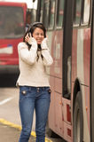 Woman walking on the city street covering her ears Stock Photos