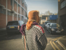 Woman walking in a city in the winter Royalty Free Stock Photos