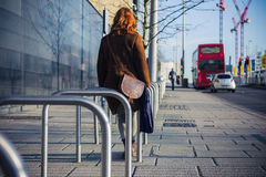 Woman walking in a city in the winter Stock Image