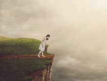 Woman walking on cliff. Woman walking on path that leads to a tall cliff