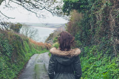 Woman walking on country road Royalty Free Stock Images