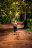 Woman  walking on country road Royalty Free Stock Photos