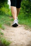 Woman Walking Cross Country and Trail Stock Photos