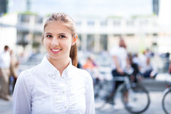 Woman walking in a crowded square Stock Photos