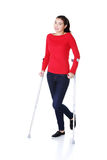 Woman walking with crutches Royalty Free Stock Images