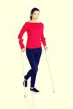 Woman walking with crutches Stock Photography