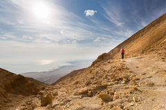 Woman walking desert mountain. Stock Images