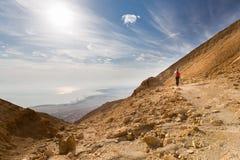 Woman walking desert mountain. Stock Images