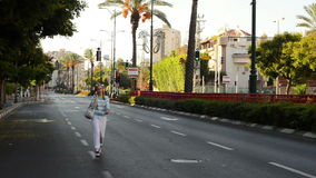 Woman walking in deserted city stock footage