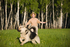 Woman walking with dog Royalty Free Stock Photography