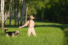 Woman walking with dog Royalty Free Stock Photos