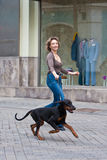The woman walking with a dog Royalty Free Stock Images