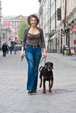 The woman walking with a dog Stock Photos