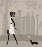 Woman walking with a dog. Stock Photography