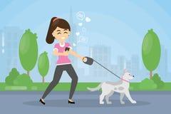 Woman walking dog. Royalty Free Stock Photos