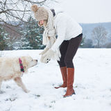 Woman walking the dog in winter Stock Photo