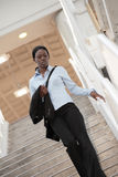 Woman walking down a staircase Royalty Free Stock Photo