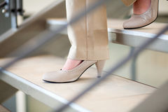woman walking down stairs Royalty Free Stock Photos
