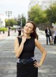 Woman walking down the street Royalty Free Stock Image