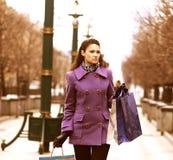 Woman walking down the street Stock Photo