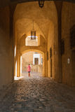 Woman walking through the entrance to the citadel in Calvi, Corsica stock photos