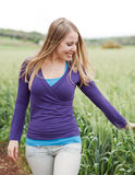 Woman walking beside the field Royalty Free Stock Photography