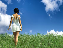 Woman walking by a field Stock Photography