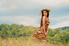 Woman walking in field. Russia. Teploozersk village Royalty Free Stock Image