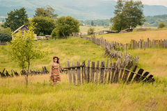 Woman walking in field. Russia. Teploozersk village Royalty Free Stock Images