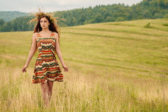 Woman walking in field. Russia. Teploozersk village Stock Images