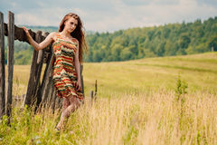 Woman walking in field. Russia. Teploozersk village Stock Photography