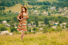 Woman walking in field. Russia. Teploozersk village Stock Photos