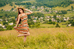 Woman walking in field. Russia. Teploozersk village Royalty Free Stock Photo