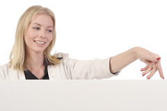 Woman with walking fingers on board. Blond smiling woman in white business suit with walking fingers on the edge of white board  on white Stock Images