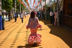 The woman walking with the flamenco dress royalty free stock photo