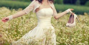 Woman walking on flower meadow Stock Photo