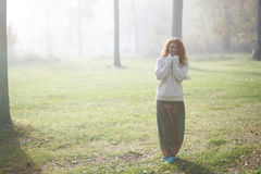 Woman walking in foggy forest Royalty Free Stock Image