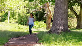 Woman walking on a footpath Stock Image
